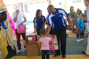 Maldonado and his wife, Janelise, distributed toys to more than 250 kids on Sunday.