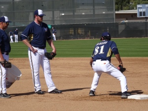 New Double-A manager Carlos Subero working with Hunter Morris
